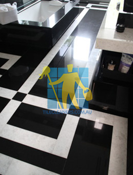 absolute black granite slab floor with white quartzite bands West Swan