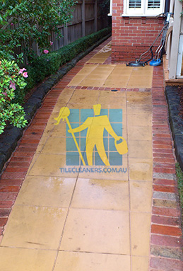 outdoor sandstone tiles pavers wet from cleaning with quarry tiles around Perth